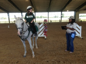 PETS rider answers horsemanship questions from a OPRC judge before moving on to the next event. (PETS photo)